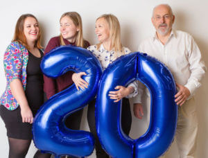 Family celebrating 20th Anniversary